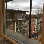 utsikt från lägenhet in på gården